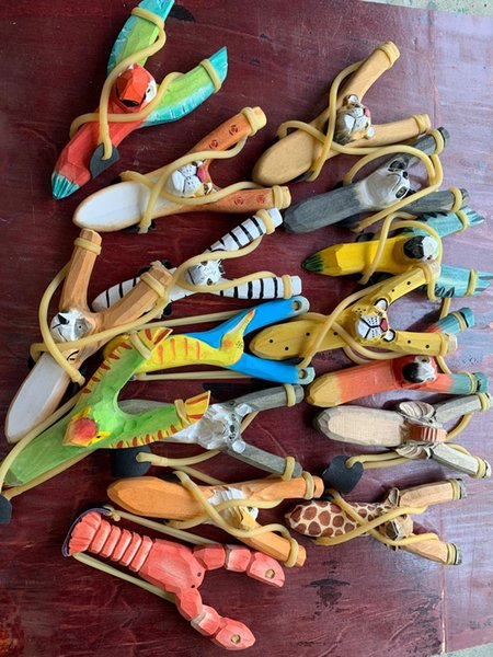 top popular Mixed Styles Creative Wood Carving Animal Slingshot Cartoon Animals Hand-Painted Wooden Slingshot Crafts Kids Gift L273 2020