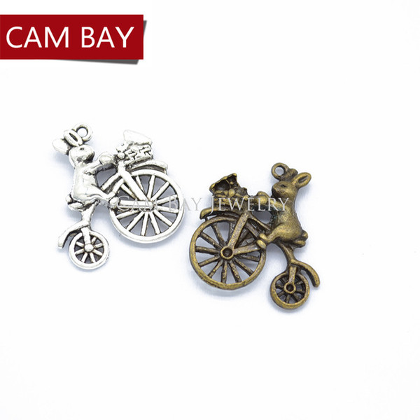 50pcs Rabbit riding a bicycle Charms for Necklace Jewelry Making Tibetan silver Charms Metal Pendants 23*21mm D9259
