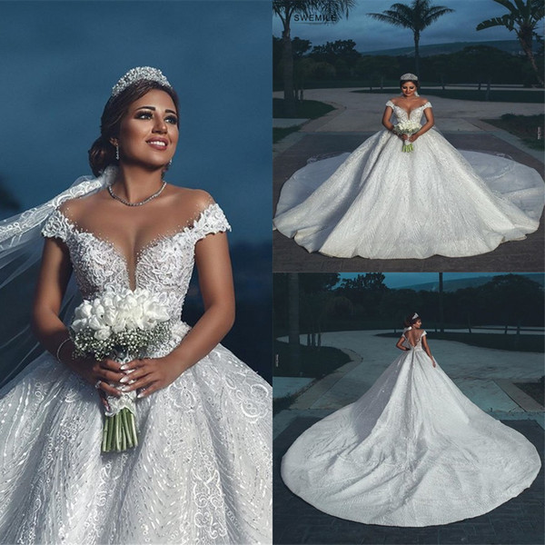 Luxury Arabic Ball Gown Wedding Dresses Elegant Off Shoulder Beads Appliques 3D Designed Sexy Backless Long Train Bridal Gowns