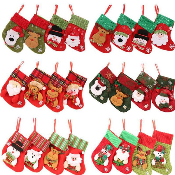 top popular 31 Designs Christmas Stockings Gifts Bag Candy Bag Christmas Tree Ornament Xmas Cutlery Bag Home Party Decorations 2020