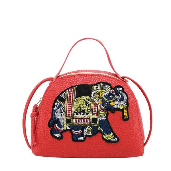 Fashion wild mini shoulder diagonal embroidery embroidery elephant rope shell ladies bag Fabric texture PU Lining texture
