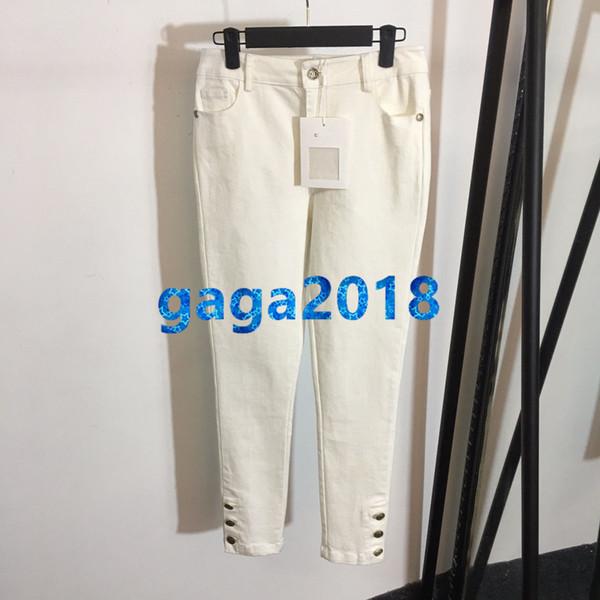 pantaloni da donna in denim bianco con bottoni in metallo jeans alta custom slim a matita aderente lungo pantalone primavera estate nuovi pantaloni milano della passerella