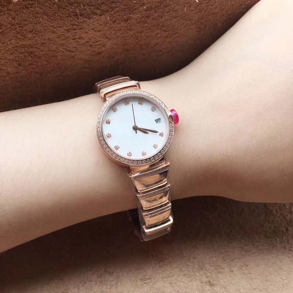 Exquise Quartz Bracklet Womens Wristwatch 29MM or en acier inoxydable Bracelet de diamants et lunette Date Femmes Watch Ladies Watches Cadran Blanc