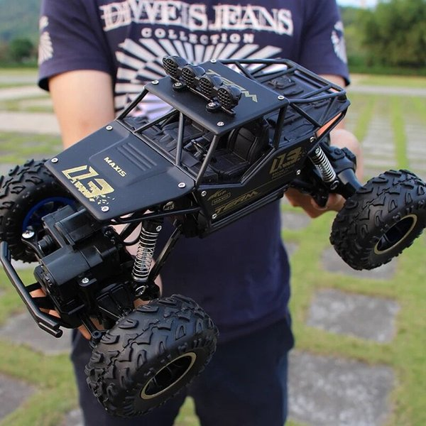1:16 4WD RC Cars Alloy Speed Radio Control RC Cars Toys Buggy 2017 High Speed Trucks Off-Road Trucks Toys para niños de regalo