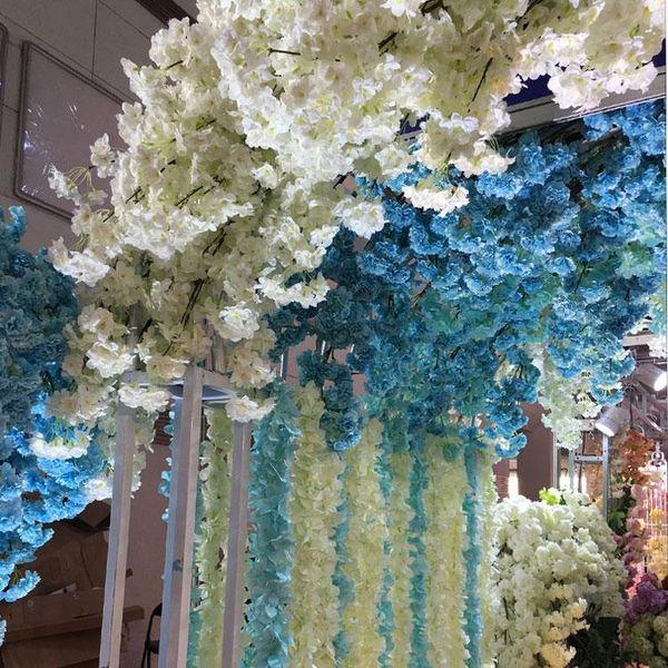 Viti di glicine di seta di fiori di ramo di fiori di ciliegio artificiali belli per la decorazione di cerimonia nuziale domestica Bouquet di fiori 5 pezzi