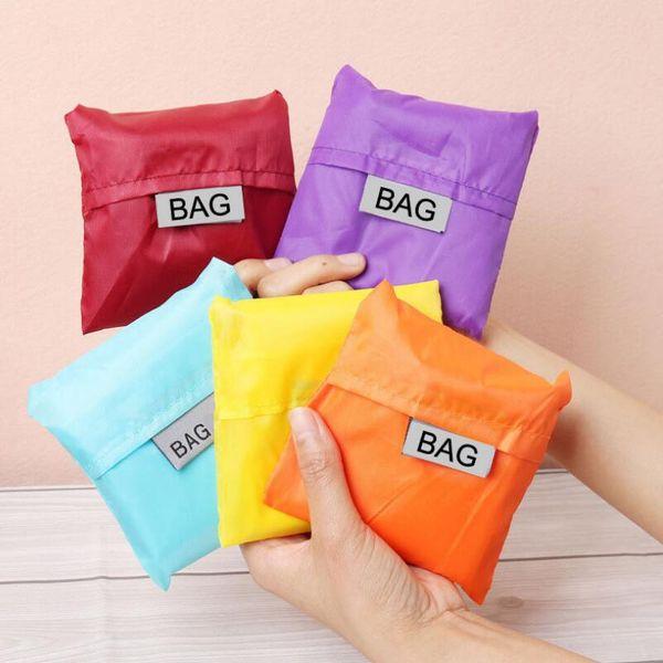 top popular Eco Friendly Storage Handbag Foldable Wearable Shopping Bags Reusable portable Grocery Nylon Large Bag Pure Color 2019