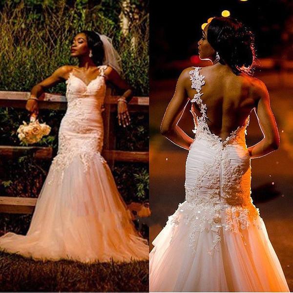 Abiti da sposa africani backless sexy senza maniche cinghie di spaghetti Applique di pizzo sirena scollo a V lunghezza del pavimento abiti da sposa 2019