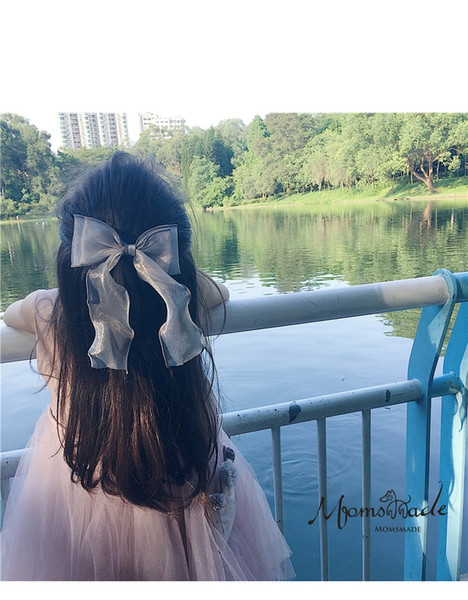 The new style of children's hair is a beautiful imported curling bow hairpin for girls