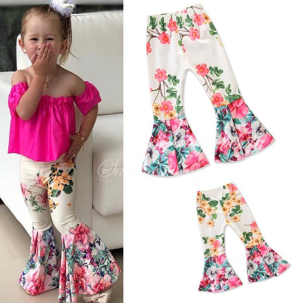 Al por menor de los bebés floral blanco Impreso Pantalones acampanados pantalones medias de las polainas de los niños pantalones de chándal diseñador de moda boutique de ropa de los niños