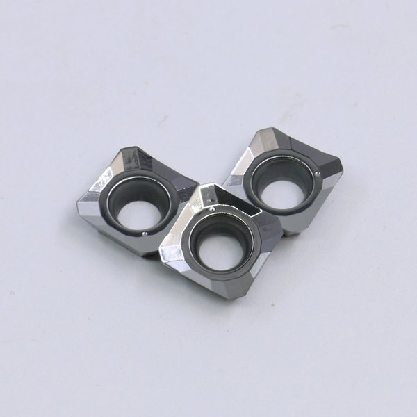 Inserções de carboneto de tungstênio de alta precisão SEHW1204 com processo de moagem de máquina inteira usado para processamento de cobre de alumínio