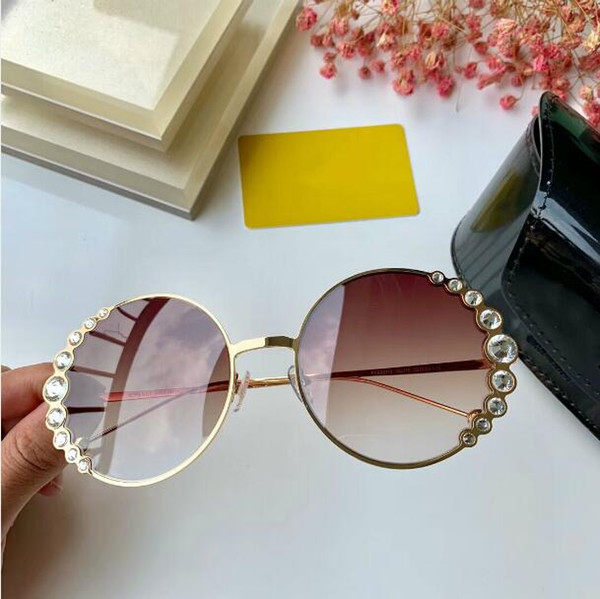 2019 Hot fashion brand Round shape sunglasses for women Ribbons and Crystals sunglasses UV400 Eyewear Metal frame Gradient lenses FF0324/S