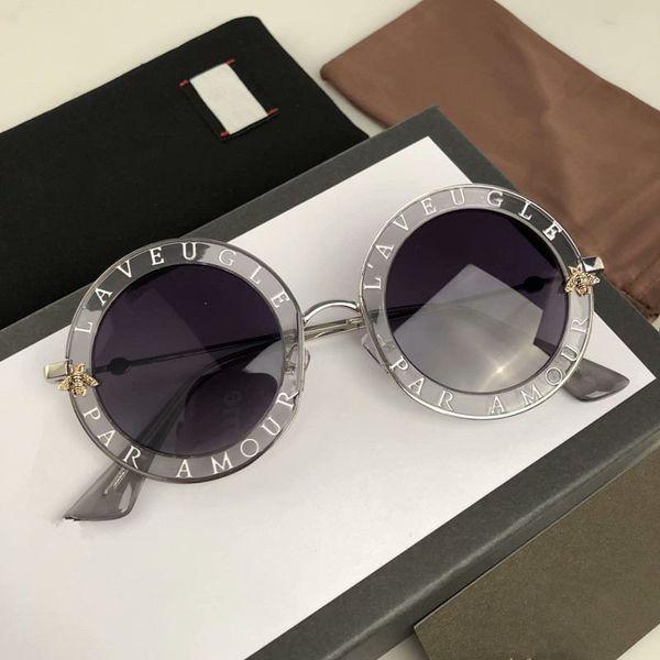 Caldo marchio New Fashion 0113 Occhiali da sole Montature da donna Occhiali da sole neri Scudo metallico Occhiali da sole con montatura dorata Occhiali neri Nuovo stile Moda