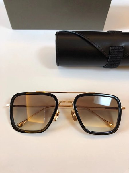 black gold with brown lens