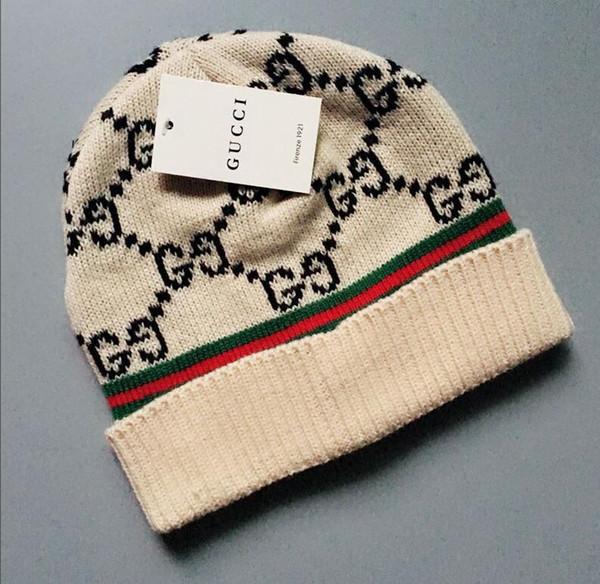 Envío libre hizo punto los casquillos rojos caliente Moda de punto Cap otoño invierno de algodón para hombres de las mujeres del sombrero nuevo al por mayor de 4 colores