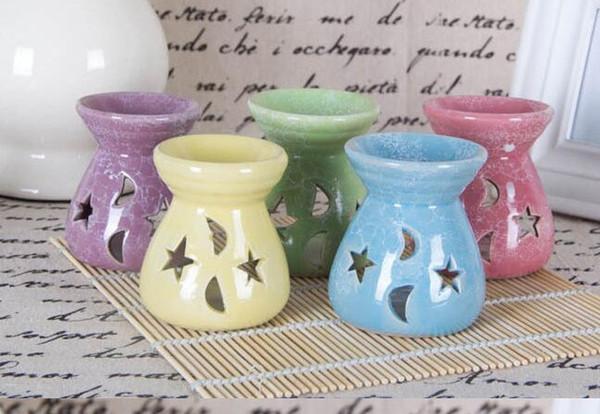 Lámparas de aceite esencial de cerámica Estrellas huecas Patrón de luna Perfume de aceite esencial simple Quemadores de incienso de vela