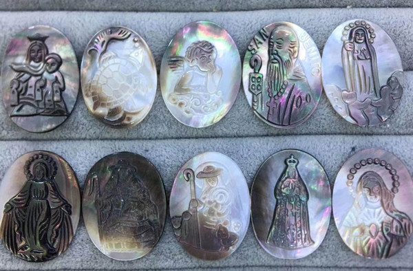 top popular Wholesael 6pcs 40x30mm Mother of Pearl shell jewlery oval egg Mary Jesus Cameo Carved Christ Cameo grey black shell pendant Beads 2021