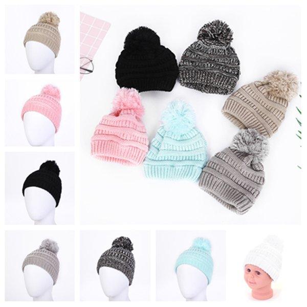 Nette Baby-Strickmütze-Art und Weise scherzt warme Winterhüte weiche Pelz-Pom-Ball-Kappen-Süßigkeit-Farben-Häkelarbeit-Beanie-Kappe T2C5076