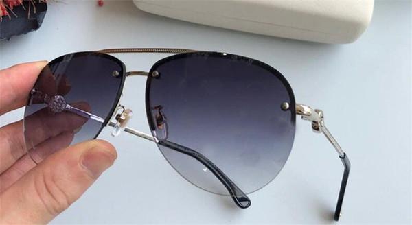 Luxury-Wholesale new fashion designer sunglasses 2195 metal frameless popular avant-garde style top quality outdoor uv400 lens eyewear