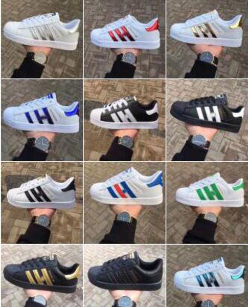 2020 moda de primavera y otoño Nueva Marca Hombres Mujeres súper estrellas súper zapatos tamaño de oro 36-44 Zapatillas de skate Zapatos planos regalo de Navidad