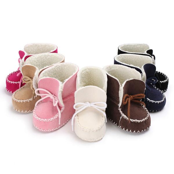 Neue Schaffell-echtes Leder-Wollpelzbaby Winter lädt Säuglingsmädchen warme Mokassinschuhe mit Plüsch schnüren sich oben Beuten auf