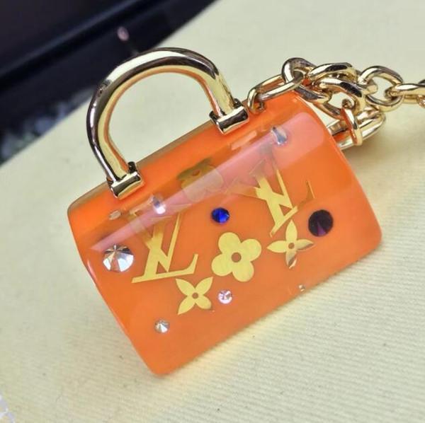 Nuevo clásico jalea llavero de color billetera colgante bolsa de coche hebilla cadena llavero hombres y mujeres regalo llavero con caja