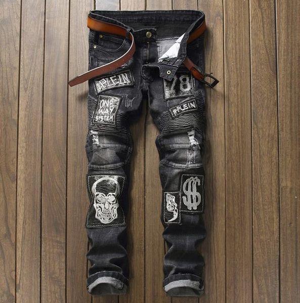 Dólar Crânio Remendo Calça Jeans Mens Punk Rock Buraco Rasgado Motociclista Jeans Bordado Preto Rasgado Denim Magro Personalidade Clubwear 003-4