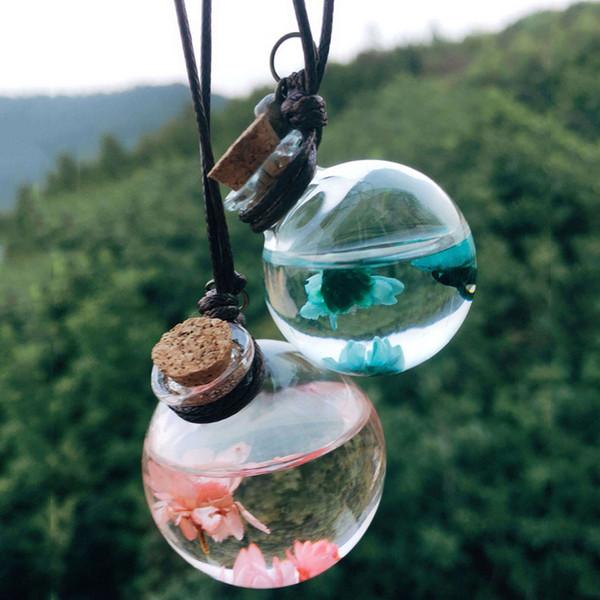 Botella de perfume del coche de la flor de vacío que cuelga redondo Cubo coche de cristal Botellas de la fragancia Aceites Esenciales Difusores de perfume colgante del ornamento DBC BH2655