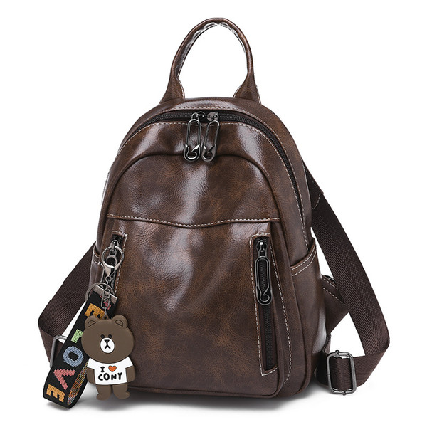 fashion lady backpack decorated with bear doll high quality double shoulder bag black and brown school bag for women