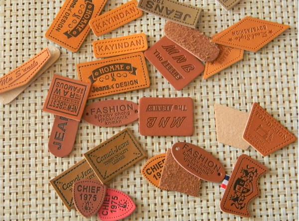 8262586a5b 250 unids Personalizado simulación cuero parches bolsa etiqueta etiqueta de  cuero falso para jeans etiqueta de