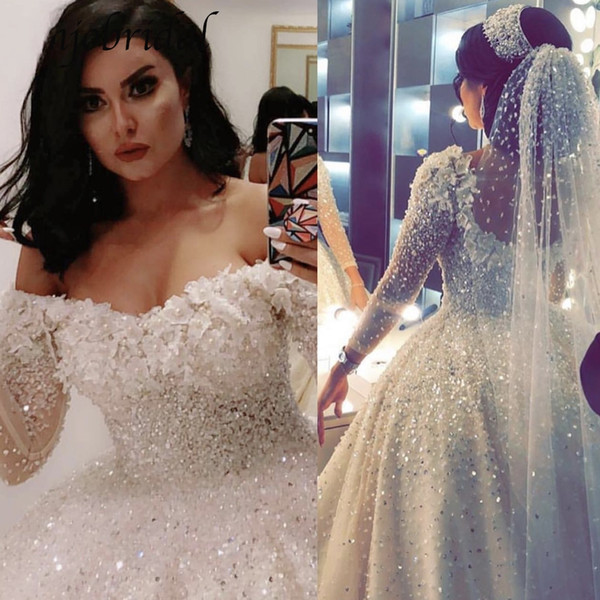 Wedding Dresses 2019 Ball Gown Off the Shoulder Sheer Long Sleeve 3D Flowers Crystal Pearls Bling Backless Court Train Arabic Luxury Bridal