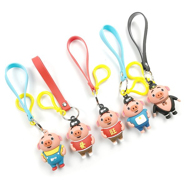 The new cartoon is lovely and prosperous Zhu Bajie key chain PVC silicone Pig doll hanging a baby machine gift