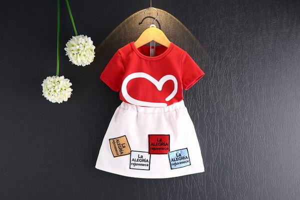 Neue Sommer-Mädchen-Kleidungsbabykurzschlusshülsen-Liebest-shirt + Fleckenröcke 2pcs Mädchen-Sommer, der 5s / l kleidet