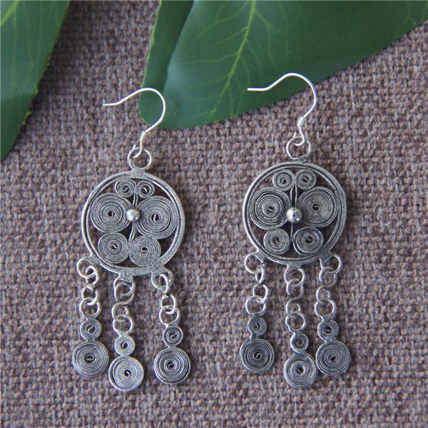 Hand-woven Miao silver butterfly tassel earrings female models fashion wild earrings Yunnan ethnic vintage jewelry