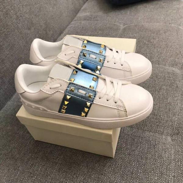 2019 Chaussures de sport classiques Chaussures blanches rivetées pour hommes et femmes au printemps et à l'automne de chaussures de marques de créateurs, chaussures de sport en cuir à semelles plates