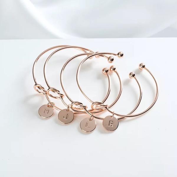 Vendita calda nuovo 26 A-Z inglese lettera braccialetto iniziale argento oro lettera braccialetto di fascino amore bowknot polsini polsini dei monili delle donne di modo