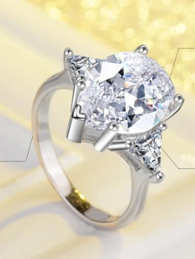 Simulated large carat diamond ring with water drop diamond ring for ladies with zircon trigonometric exaggerated pigeon eggs