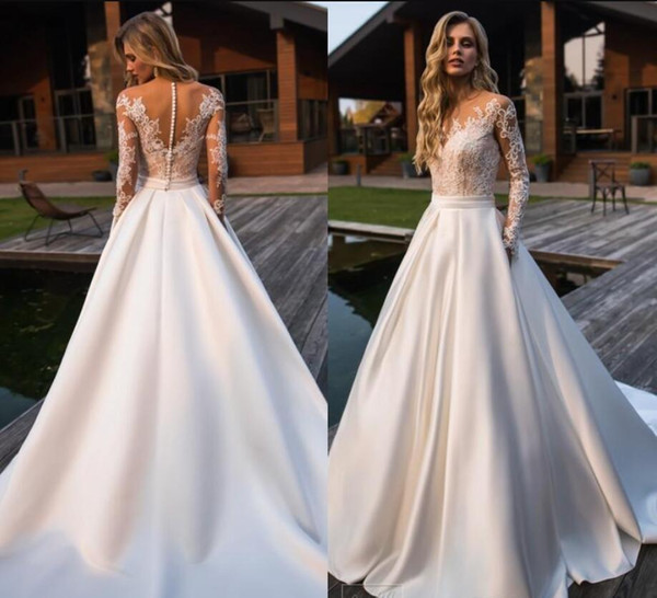 Charming Lace Boho Beach Wedding Dresses with Sheer Long Sleeves Sheer Neck Applique Court Train A Line Garden Bridal Gowns