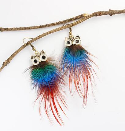 nuovo caldo europeo e americano personalità popolare piuma di pavone gufo orecchini lunghi moda classico elegante nuovo