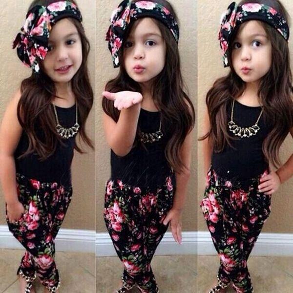 Nueva moda para bebés niñas ropa conjunto de colores sólidos blanco negro camiseta chaleco + floral pantalones rasgados diadema niños ropa traje