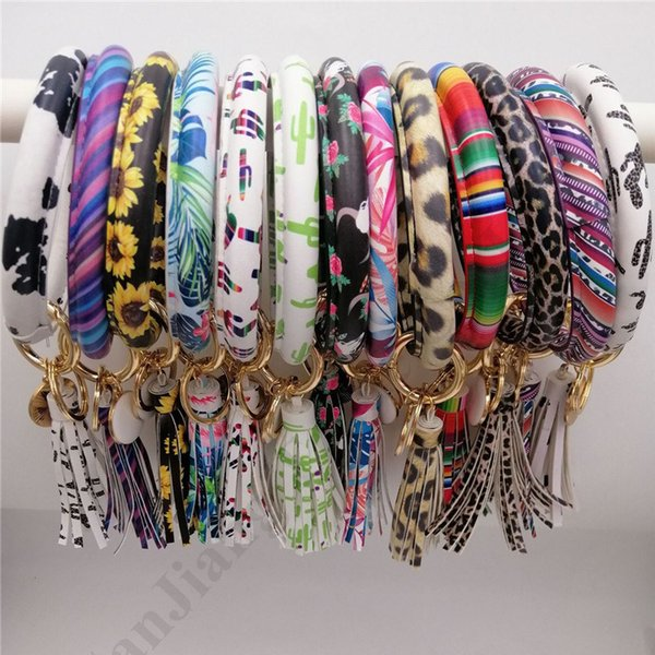 Bracelets Glands femmes PU gainé de cuir Porte-clés porte-clés Leopard Wristband couleur de sucrerie de tournesol goutte à goutte d'huile Bracelet Chaînes 33 Couleur A101702