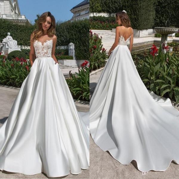 2020 Design Une Ligne Satin De Mariage Dreses Modeste Sheer Neck V Cut Backless Robe De Mariée Avec Des Poches En Dentelle Long Train Robe Robes