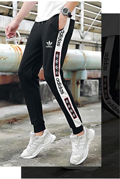 Белые полосатые буквы принт женщины мужчины бегунов мода осень спортивные брюки для бега мужские случайные мужские дизайнерские брюки