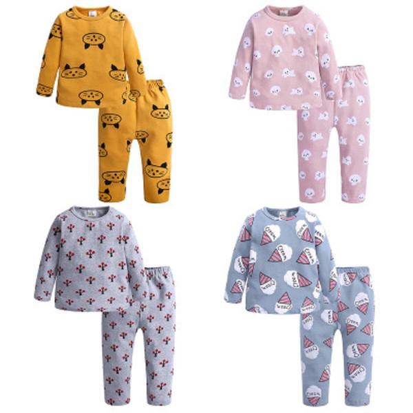 Conjunto de pijamas para niños Conjunto de pantalones de algodón de tiro en casa Traje de servicio doméstico Servicio de impresión linda de cuatro colores Manga larga 24