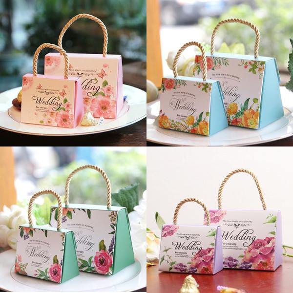 Sacchetti del regalo della scatola di Candy di stampa floreale di nozze che imballano borsa con le maniglie che imballano per i sacchetti del regalo dei biglietti di S. Valentino dei gioielli