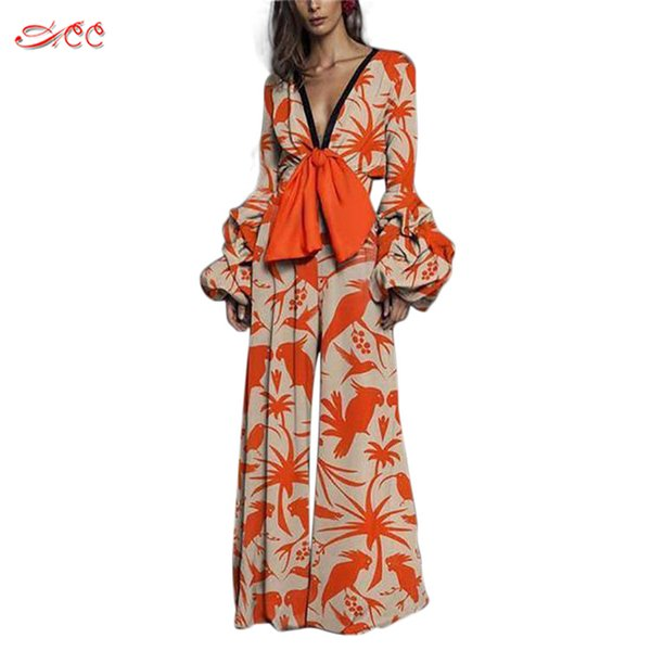 Sexy deep v-neck jumpsuit long wide leg pants personality big bow straight straight jumpsuit orange lantern sleeve flared pants