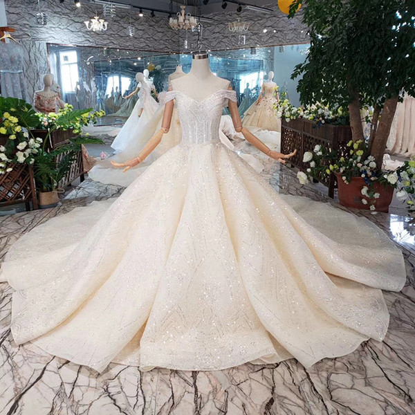 2019 El más nuevo vestido de boda de Melbourne Beach Lentejuelas brillantes Vestidos de boda con cuello de novia Expuesto Boning Manga corta con cordones Volver Vestido de novia
