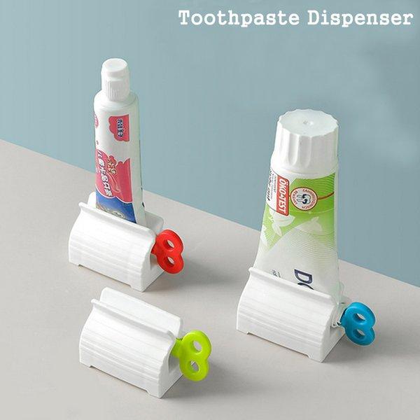 top popular Multifunctional Manual Rotation Bathroom Plastic Cream Tube Squeezer Dispenser Rolling Tube Squeezer Toothpaste Dispenser 2021