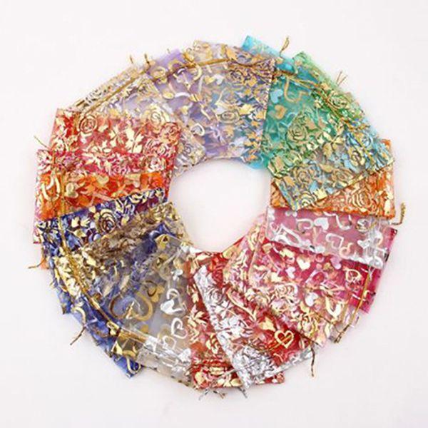 100pcs / lot del fiore del cuore piccole borse di organza favoriscono le borse di imballaggio dei gioielli del sacchetto del regalo di Natale di nozze dei sacchetti disegnabili