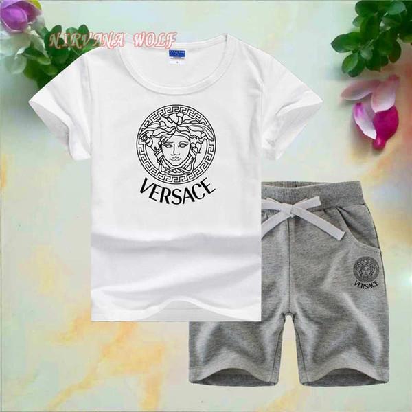VSC Little Kids Sets 1-7T Pantaloni corti da bambino T-shirt Pure Color 2Pcs / sets Ragazzi ragazze Pure Cotton Head da donna Logo stile Set estivo