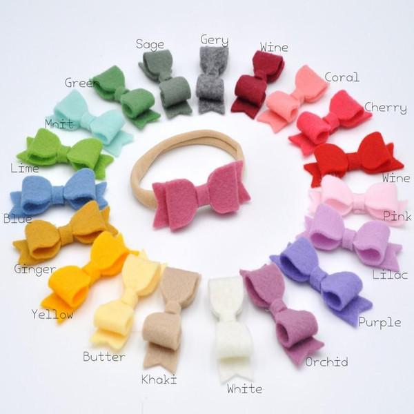 20pcs / lot hecho a mano Fieltro mini arco de la venda clips del arco lindo del pelo de nylon Cinta de cabeza para bebés Accesorios para el bebé